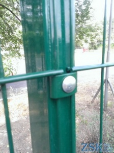 Pillar with anti-vandal fastening